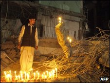 Candles lit in tribute to victims of this week's car bomb, at the blast site in Peshawar on 31 October 2009