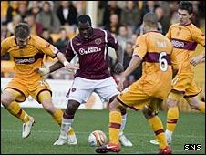 Hearts striker Christian Nade finds himself outnumbered