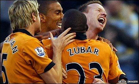Wolves players celebrate scoring against Stoke