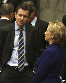 Sir John Sawers talking to Hillary Clinton