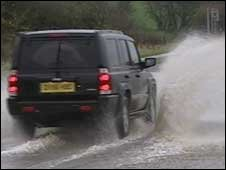Van driving through flood water