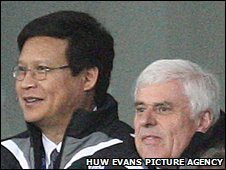 Businessman Datuk Chan Tien Ghee watches Cardiff play with chairman Peter Ridsdale