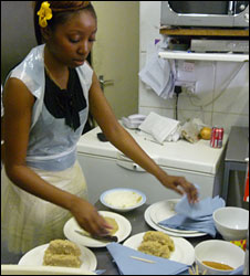 People learning to cook Egusi