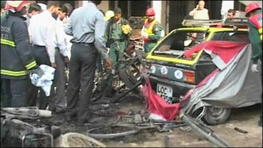 Car wreckage following bomb blast