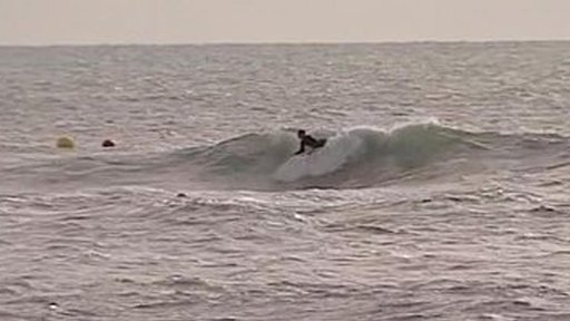 Surfer surfing the reef