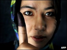 Afghan voter shows her inked finger after the 2009 election