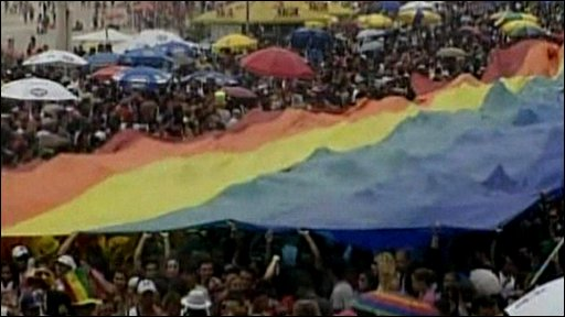 Thousands of people under rainbow flag in Rio