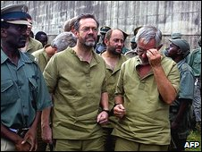 Simon Mann (left, in glasses) in prison in Zimbabwe