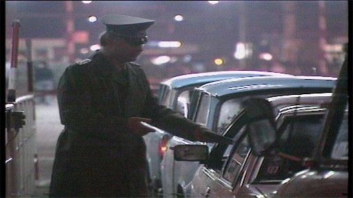 Berlin border guard checks papers 1989