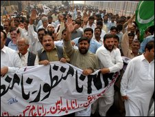 Pakistani protesters take street to oppose the National Reconciliation Ordinance, which gives protection to President Asif Ali Zardari and other law makers from corruption cases, in Multan, Pakistan on Monday, Nov. 2, 2009