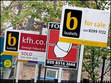 Estate agent boards on a street in London