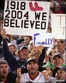 A Boston Red Sox fan's banner tells the story of their 2004 World Series baseball win
