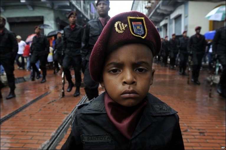 A boy dressed as an Honor Guard soldier takes part in an Independence Day parade in Panama City