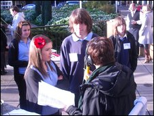 students being interviewed by reporter