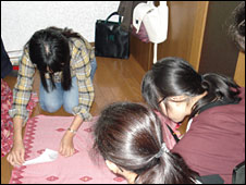 Burmese refugees making clothes at the Tokyo apartment