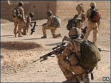 British and Afghan soldiers searching a village for Taliban forces