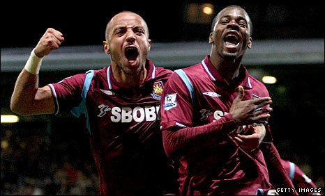 Julien Faubert (left) and Zavon Hines celebrate West Ham's dramatic late winner