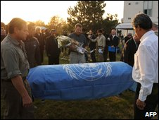 UN employees carry a slain colleague's coffin at Kabul airport on 3 November 2009