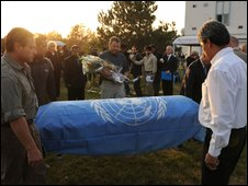 UN employees carry the coffin of a colleague killed in last week's attack, at Kabul airport on 3 November 2009