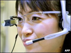 Woman wearing subtitle specs, AFP/NEC