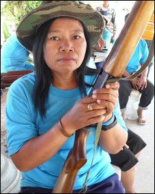 Monthira Peng-Iad, a farmer who has joined a local militia