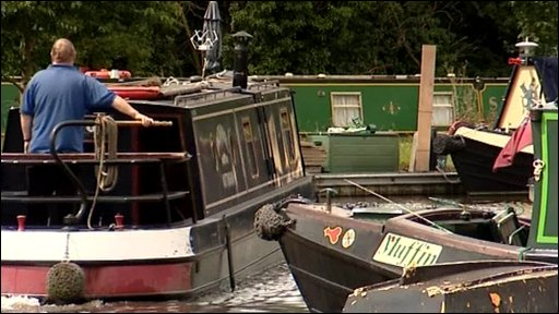 Man steers canal boat