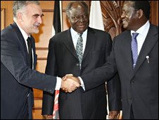 Kenyan President Mwai Kibaki (C) and Kenyan Prime Minister Raila Odinga (R) greeting the International Criminal Court chief prosecutor Luis Moreno-Ocampo