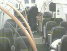 CCTV footage of Palmer and Hardy surrounding Mr Kennedy on the train