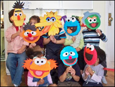 Children with Sesame St masks