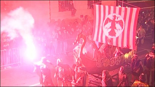 Flares and a model of a Viking ship at Lewes Bonfire.