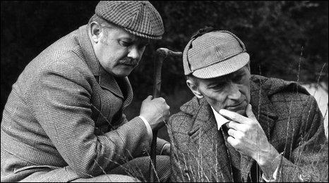 Nigel Stock as Dr Watson, Peter Cushing as Sherlock Holmes.