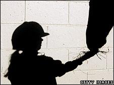Shadow of girl feeding a horse