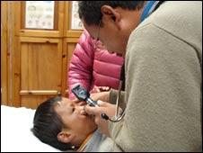 Dr Tsering Wangdi Sherpa checks a patient