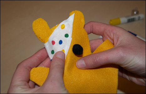 Attaching the bandage to Pudsey