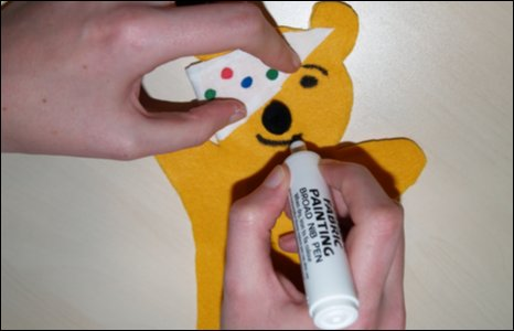 Drawing a smile on to Pudsey's face