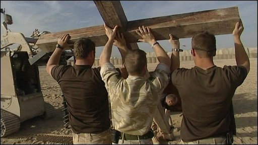 UK troops in Afghanistan erect a cross for a remembrance service