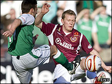 Kevin McBride and Andrew Driver battle for possession