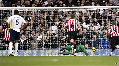 Heurelho Gomes saves from Darren Bent's penalty