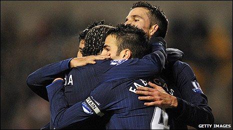 Arsenal celebrate scoring against Wolves