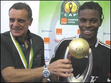 TP Mazembe captain Tresor Mputu Mabi (right) and coach Diego Garzitto with the Champions League trophy