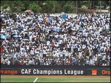Fans of TP Mazembe watch the second leg of the final of the African Champions League