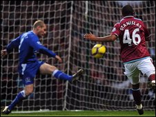 Tony Hibbert slices into his own net