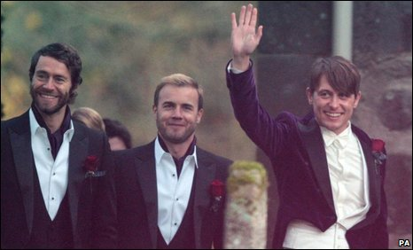 Mark Owen (right) arrives with Howard Donald and Gary Barlow