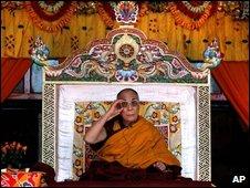 Tibetan spiritual leader the Dalai Lama looks on during a preaching session in Tawang, in the northeastern Arunachal Pradesh state, India, Monday, Nov. 9, 2009