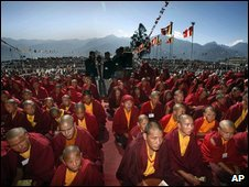 Thousands of Buddhist devotees listen to Tibetan spiritual leader the Dalai Lama during a preaching session in Tawang, in the northeastern Arunachal Pradesh state, India, Monday, Nov. 9, 2009