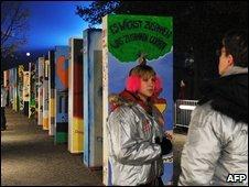 Dominos along the Berlin Wall