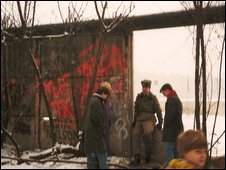 East German guards talking to tourists at the Berlin Wall a week after it fell (Photo: Kerry Simons)