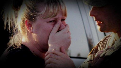 Crying woman being comforted at Fort Hood