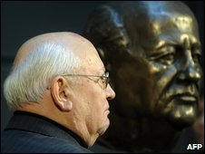 Former Soviet President Mikhail Gorbachev stands beside a new bust of himself in Berlin, 9 November 2009