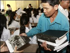 Him Huy, a former security guard of the Khmer Rouge's notorious S-21 prison, delivers the first-ever Cambodian-authored history textbook on the Khmer Rouge era